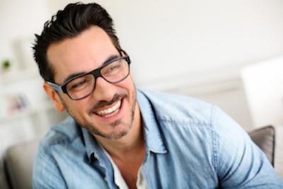 man in glasses smiling | Cosmetic dentist north tamworth