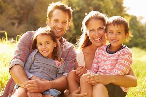 a young family sitting outside | Tamworth Dentist